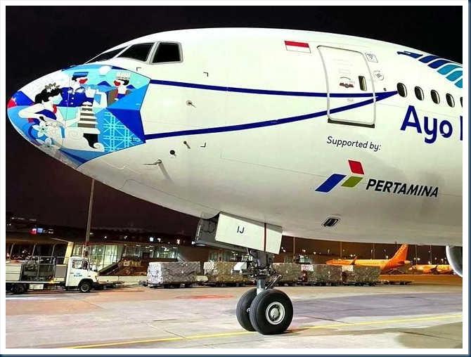 boeing_777-300er_pk-gij_ayo_pakai_masker
